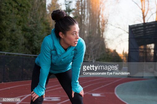 Athlete resting on track