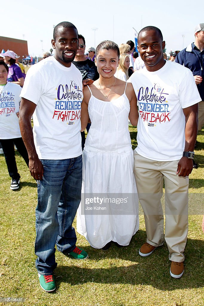 Athlete Rodney Martin (L) and Leroy Dixon pose for a photo with actress Catalina Rodriguez attends American Cancer Society's 2nd Annual Relay For Life Of Hollywood on July 30, 2011 in Hollywood, California.