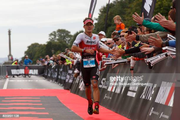 Athlete Romain Guillaume from France celebrates crossing the finish line in second place during the men race of IRONMAN 703 Dublin on August 20 2017...