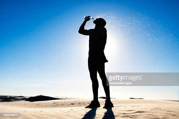 Athlete Runner Resting on Sand Dune