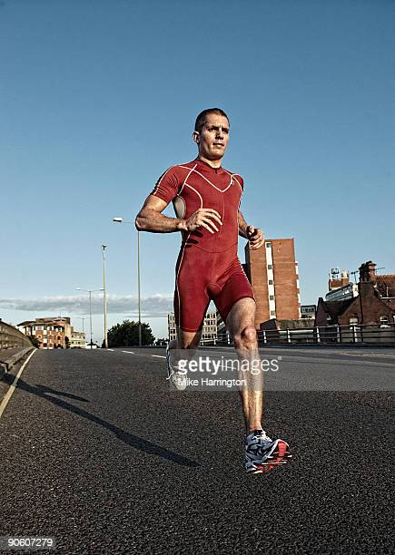 Athlete running along empty dual carriageway