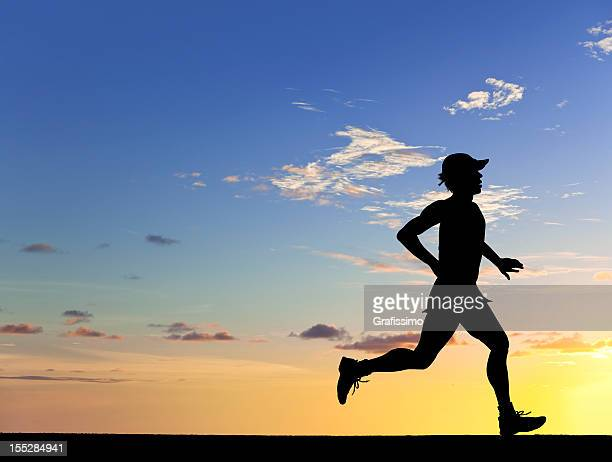 Athlete running in the sunset
