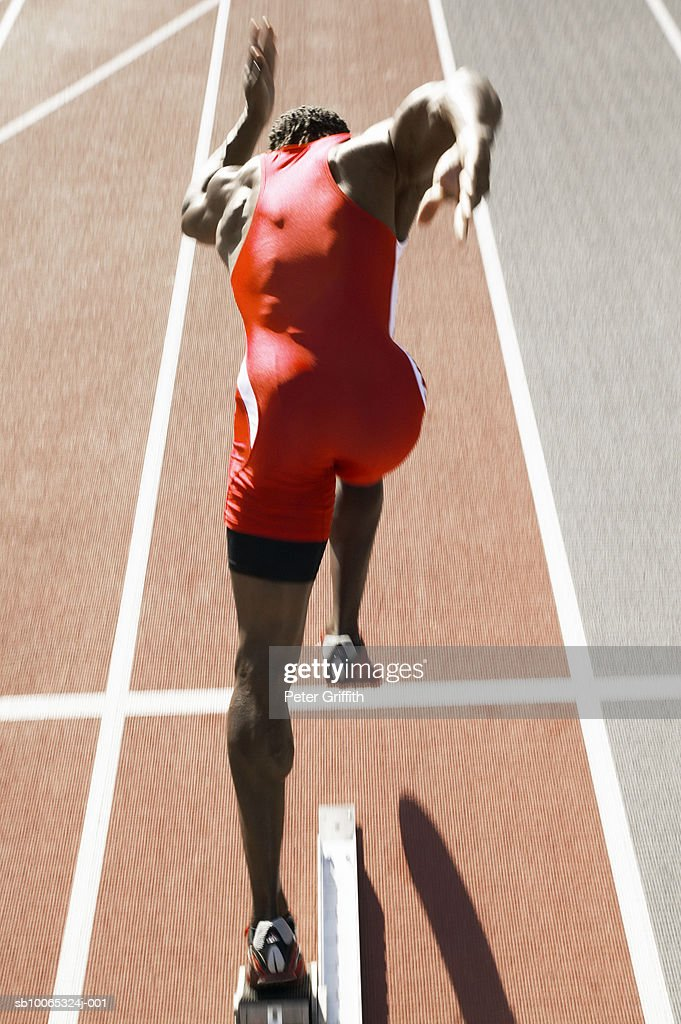 Athlete running on track, rear view : Stock Photo
