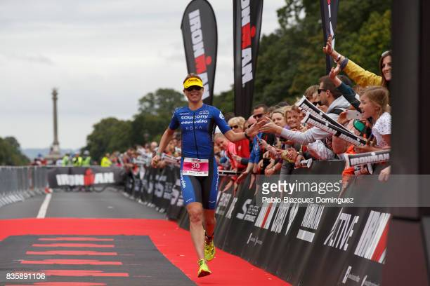 Athlete Sarah Lewis from Great Britain celebrates crossing the finish line in second place during the women race of IRONMAN 703 Dublin on August 20...