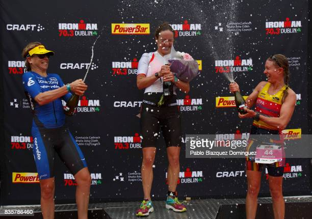 Athlete Sarah Lewis from Great Britain celebrates winning the women race of IRONMAN 703 Dublin with Sussie Chetham from Great Britain second and...