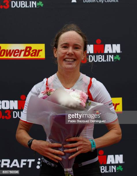 Athlete Sarah Lewis from Great Britain celebrates winning the women race of IRONMAN 703 Dublin triathlon at the finish line on August 20 2017 in...