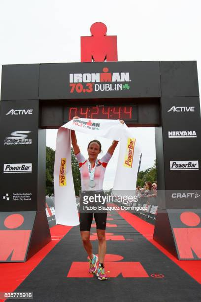 Athlete Sarah Lewis from Great Britain celebrates winning the women's race of IRONMAN 703 Dublin triathlon at the finish line on August 20 2017 in...