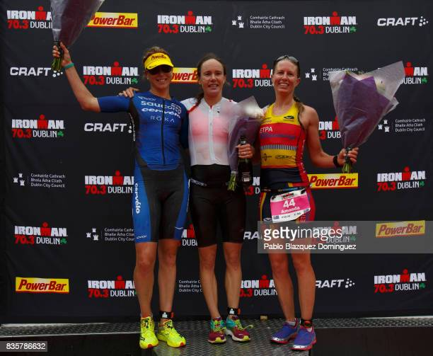 Athlete Sarah Lewis from Great Britain celebrates winning the women's race of IRONMAN 703 Dublin with Sussie Chetham from Great Britain second and...