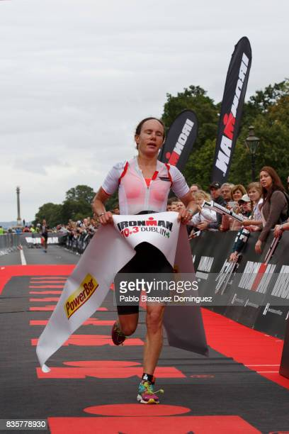 Athlete Sarah Lewis from Great Britain crosses the finish line as she wins the women's race of IRONMAN 703 Dublin triathlon on August 20 2017 in...