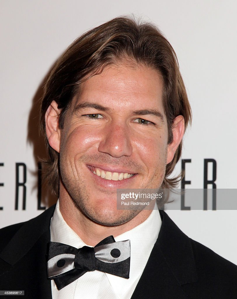 Athlete Scott Fujita arrives at 'Tie The Knot' Store Grand Opening with founder Jesse Tyler Ferguson at The Beverly Center on December 5, 2013 in Los Angeles, California.