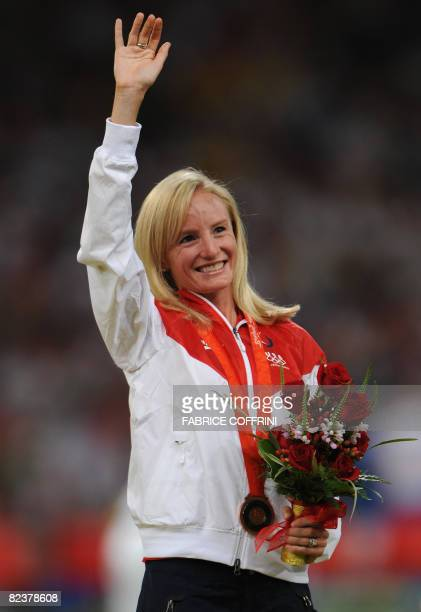 US athlete Shalane Flanagan poses with her bronze medal on the podium for the women's 10000m final at the National stadium as part of the 2008...