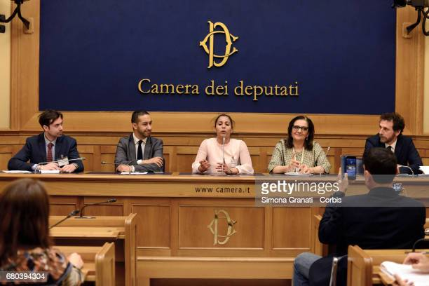 Athlete Sirine Chaarab speaks next to Communications Director Changeorg Luca Francescangeli Khalid Chaouki Deputy of the Italian Democratic Party...