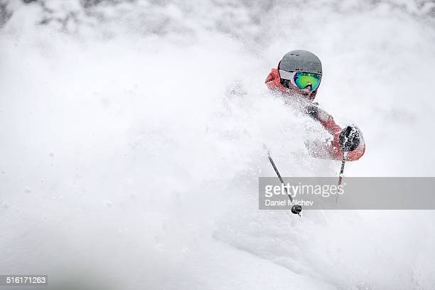 Athlete skiing deep powder in the back country.