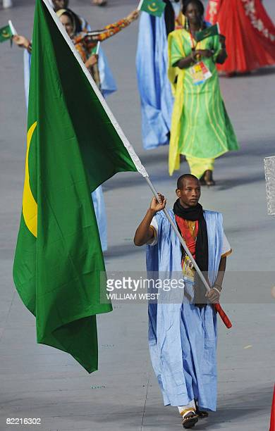 Athlete Souleymane Chebal Moctar Mauritania's flag bearer parades in front of his delegation during the 2008 Beijing Olympic Games opening ceremony...