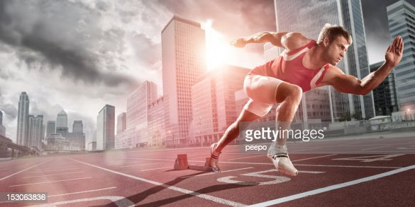 Athlete Sprinting in City