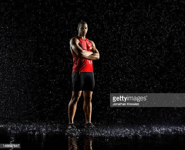 Athlete standing in rain