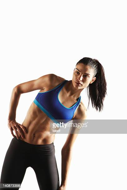 Athlete stretching with hand on hip
