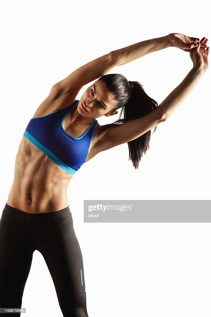 Athlete stretching with hands over head