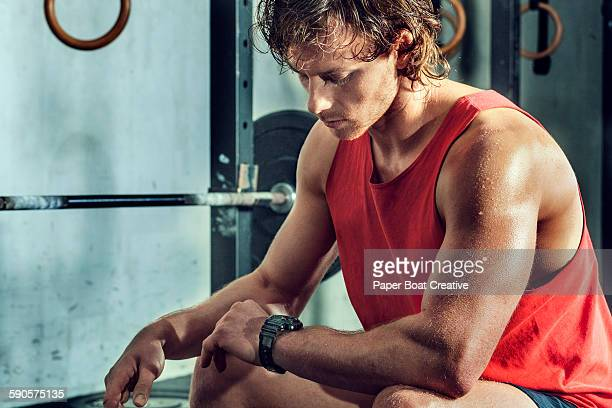 Athlete taking a break from workout, checking time