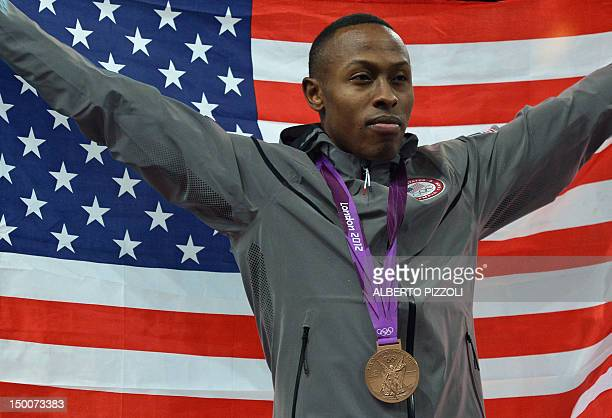 US athlete Terrence Jennings poses with his bronze medal on the podium for the men's taekwondo in the category under 68 kg as part of the London 2012...