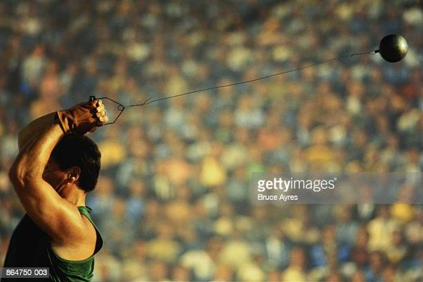 Athlete throwing hammer in competition (Digital Composite)