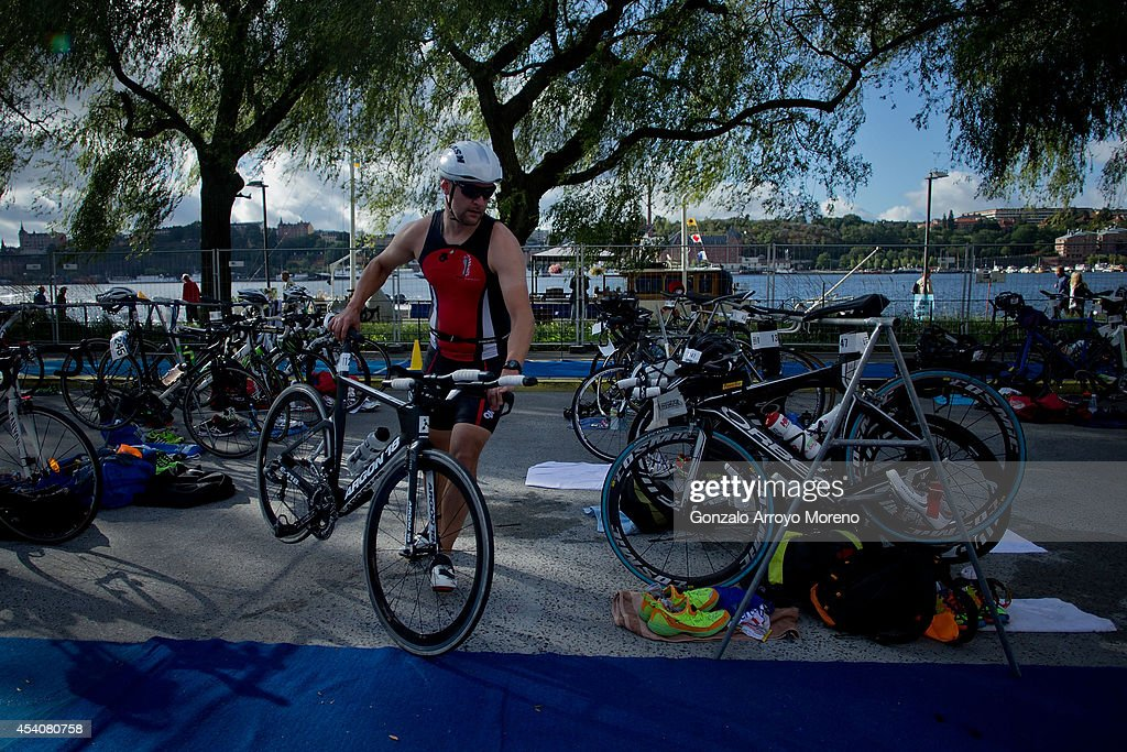 Athlete Tom Weeks takes his bikes at the transition area prior to start the biking course of one of the Age Groupers Wave Race during the ITU World Trathlon on August 24, 2014 in Stockholm, Sweden.