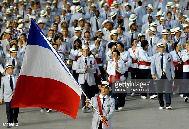 Athlete Tony Estanguet leads France's delegation parade during the 2008 Beijing Olympic Games opening ceremony on August 8 2008 at the National...