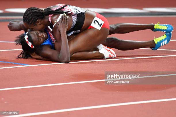 TOPSHOT US athlete Tori Bowie celebrates with Trinidad and Tobago's KellyAnn Baptiste after winning the final of the women's 100m athletics event at...