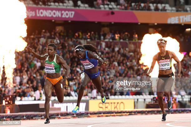 TOPSHOT US athlete Tori Bowie crosses the finish line next to Ivory Coast's Murielle Ahoure and Jamaica's Elaine Thompson to win the final of the...