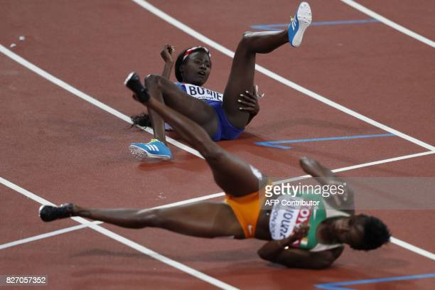 TOPSHOT US athlete Tori Bowie falls into Ivory Coast's Murielle Ahouré as she wins the final of the women's 100m athletics event at the 2017 IAAF...