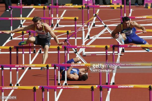 TOPSHOT US athlete Trey Hardee falls as Germany's Rico Freimuth and Ukraine's Oleksiy Kasyanov take hurdles in a heat of the men's decathlon 110m...