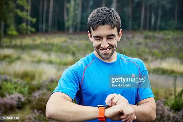 Athlete using smart watch.