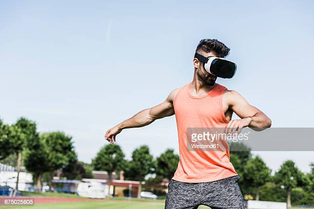 Athlete wearing virtual reality glasses