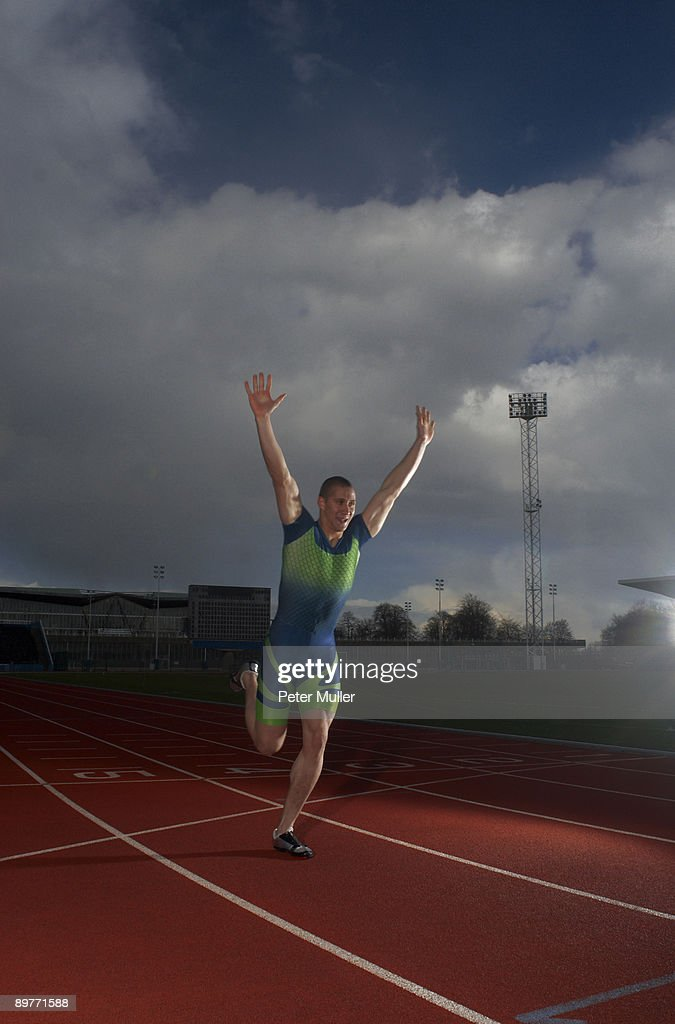 athlete winning race : Stock Photo
