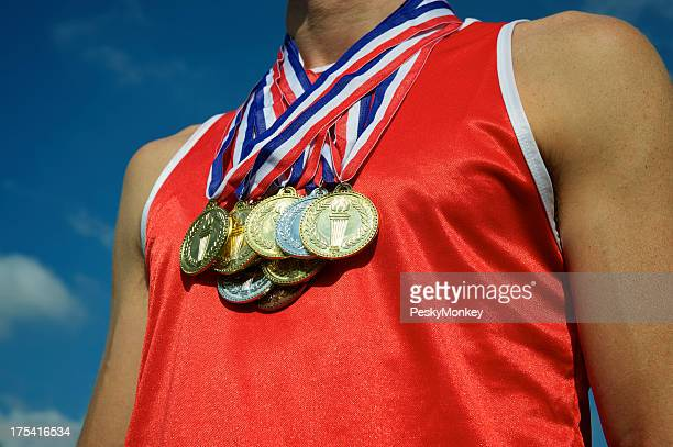 Athlete with Gold Silver Bronze Medals Bright Blue Sky