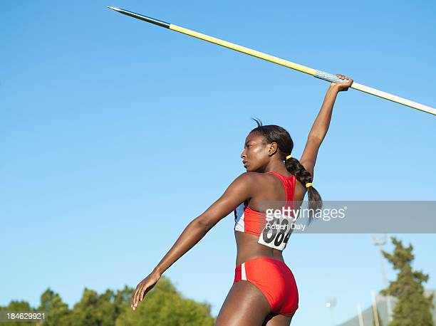 Athlete with javelin in arena