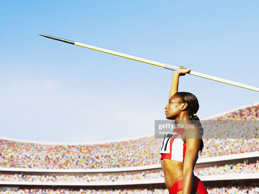 Athlete with javelin in arena : Stock Photo