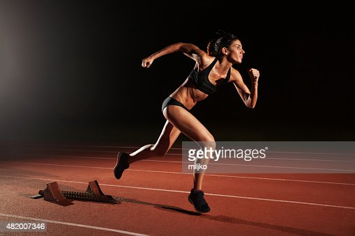 Athlete woman running on athletic racetrack