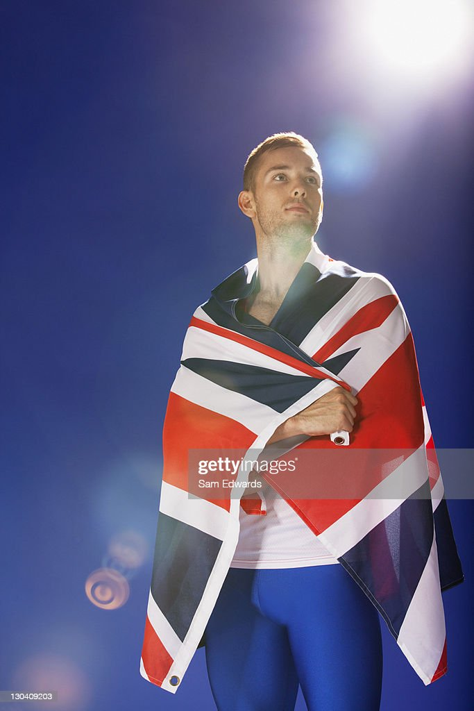 Athlete wrapped in Union Jack flag : Stock Photo