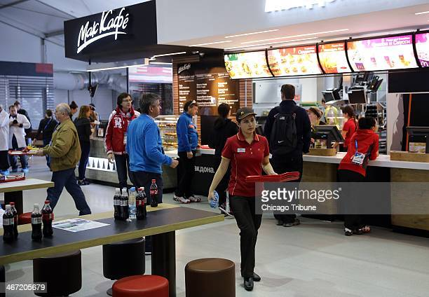 Athletes and coaches visit a McDonald's restaurant inside the Olympic Village dining hall at the Winter Olympics in Sochi Russia Thursday Feb 6 2014