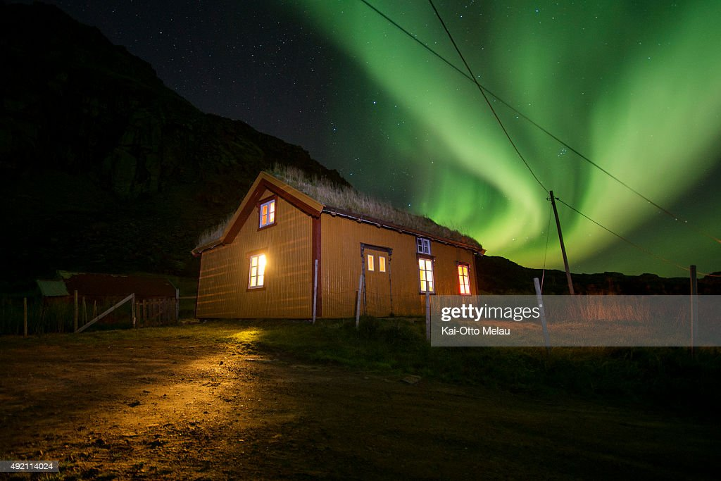 Athletes and crew rest up for the night in a cabin lit up by the northern lights on October 9, 2015 in Svolvar, Norway. Only Svein Vestoel will be doing the entire 100 miles Lofoten UltraTrail, organized by The Arctic Triple this year, and he will be accompanied by different local athletes.