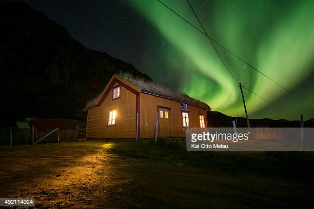 Athletes and crew rest up for the night in a cabin lit up by the northern lights on October 9 2015 in Svolvar Norway Only Svein Vestoel will be doing...