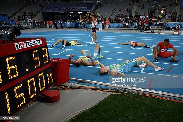 Athletes are seen exhausted at the finish line in the Men's Decathlon 1500m Heat 1 on day twelve of the 2014 Asian Games at Incheon Asiad Main...