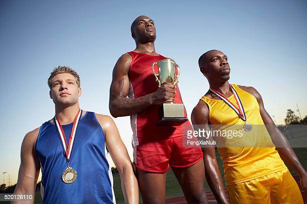 Athletes at an award ceremony