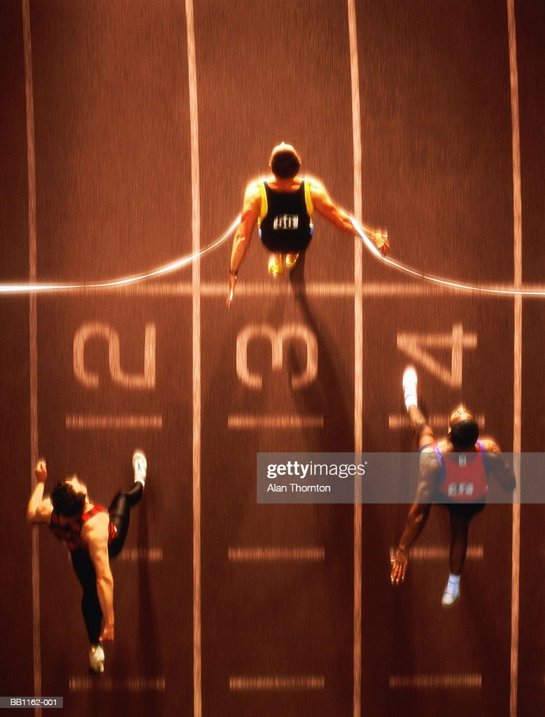 Athletes at finish line, overhead view (Digital Composite) : Stock Photo