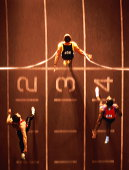 Athletes at finish line, overhead view (Digital Composite)