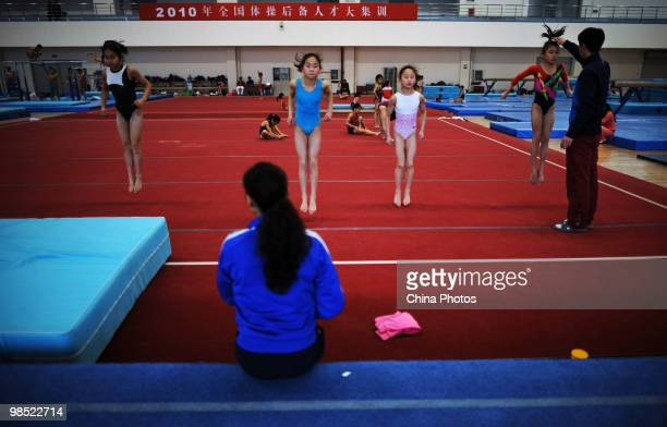 Athletes attend a training session under the instructions of coaches during the 2010 Training Camp For Country's Reserve Gymnastic Athletes at the...