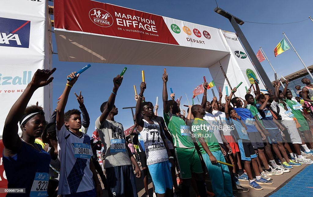 Athletes attend the start of the first ever Dakar International Marathon organised by the BTP Eiffage society on February 13, 2016 where thousands of people including numerous teenagers and children, took part in the two-day tournament. The competition started on February 13 in front of International Conference Center Abou Diouf (Cicad) on the outskirts of Dakar with different runs of 10 km and will end the day after, February 14, with a marathon. The BTP Eiffage society hosted the event to celebrates its 90 years of presence in Senegal. / AFP / SEYLLOU