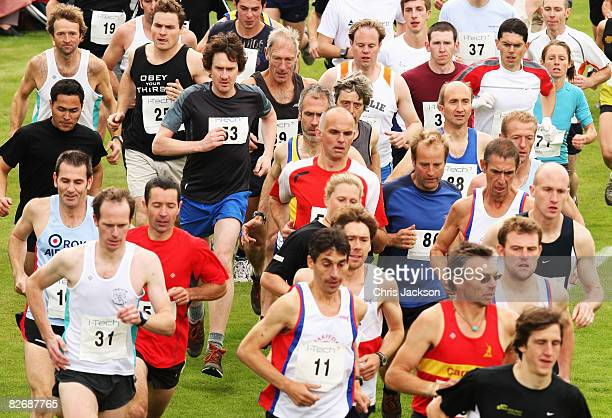 Athletes begin the traditional hill run during the Annual Braemar Highland Gathering on September 6 2008 in Braemar Scotland The Braemar Gathering is...