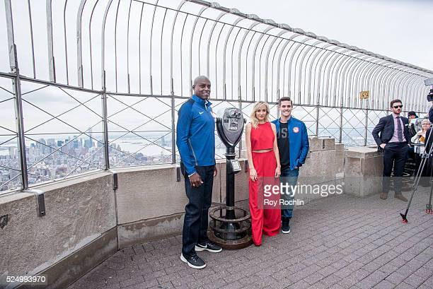 Athletes Carl Lewis Nastia Liukin and David Boudia attend as Team USA Athletes light the Empire State Building red white and blue to celebrate the...